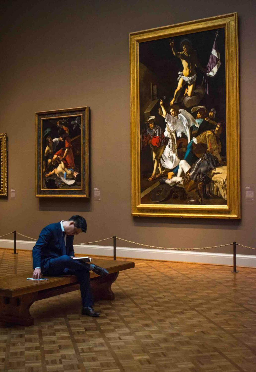 A visitor relaxes in the Art Institute of Chicago.